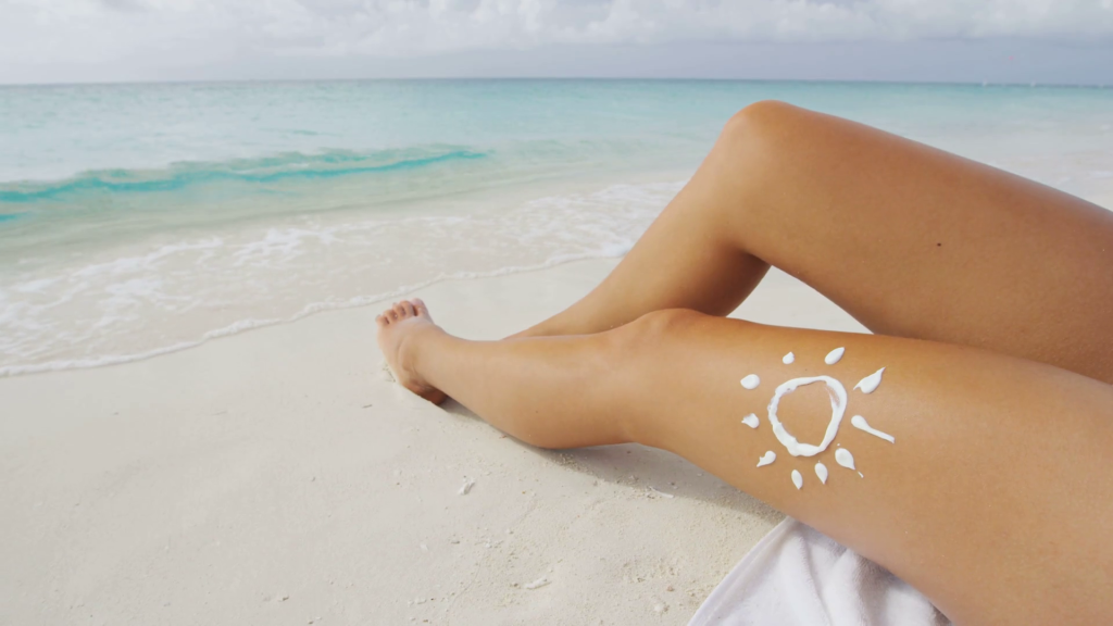 suntan-beach-woman-tanning-sexy-legs-relaxing-swimming-in-ocean-water-with-sun-drawing-in-sunscreen-lotion-sunblock-cream-solar-protection-care-against-skin-cancer-concept-wit